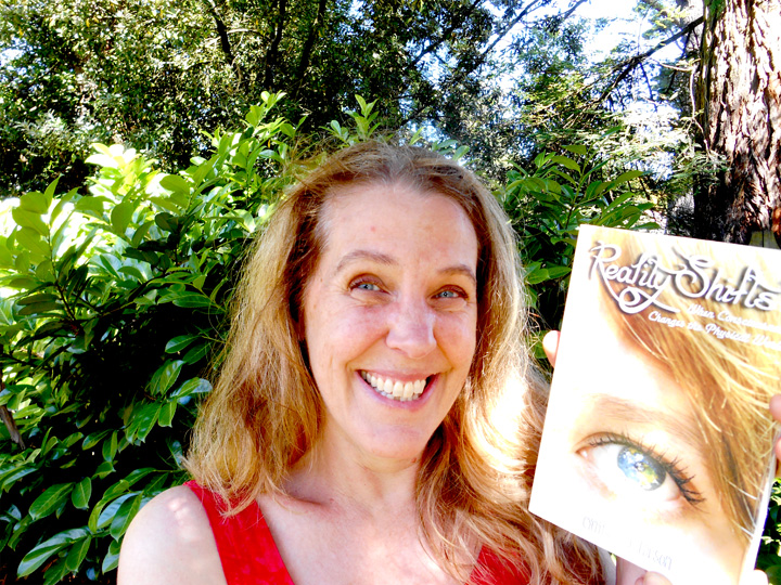 Cynthia Sue Larson with her book.